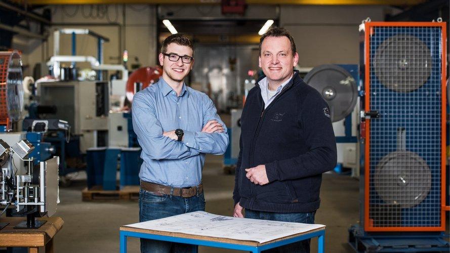 2 men with design plan